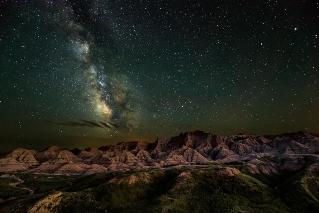 """Starry Night Erik Fremstad won in the night skies category for this photo of the Badlands of South Dakota. Though the image is breathtaking, Fremstad says """"photos cannot express the awesomeness of seeing it in person."""" PHOTOGRAPH BY ERIK FREMSTAD"""