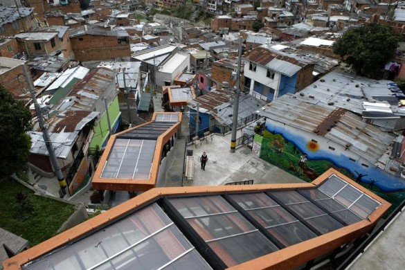 The former drug capital has sought to connect poor neighborhoods to the rest of the city. This system of outdoor escalators and plazas extends a quarter-mile up steep hills in one of Medellín's poorest districts. PHOTO: RAUL ARBOLEDA/AFP/GETTY IMAGES
