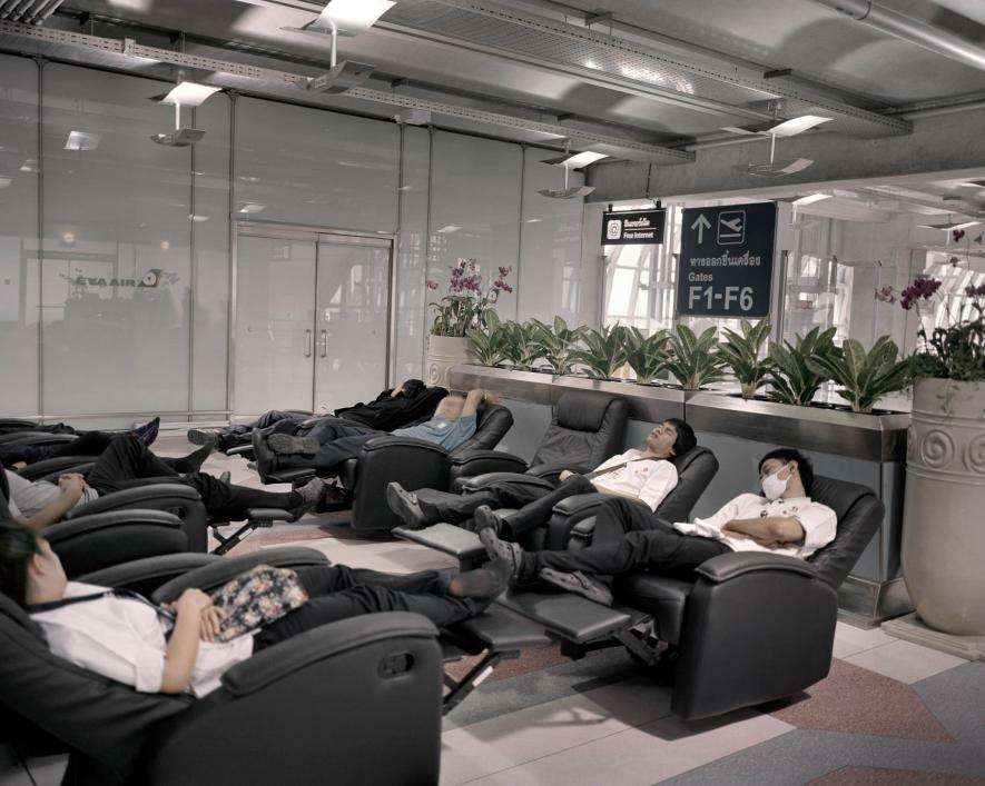 Travelers rest in recliners in New Songdo, South Korea