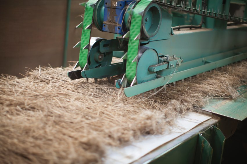 The Swiss firm Freitag is best known for its bags made from old truck tarpaulins. But the company's founders also sought to make robust trousers for their workers without relying on cotton -- and a French flax field provided them with a solution. This machine processes the harvested straw.